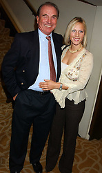 CAPT.MARK PHILLIPS and his daughter ZARA PHILLIPS at The Sir Peter O'Sullevan Charitable Trust Lunch at The Savoy, London on 23rd November 2005.<br />