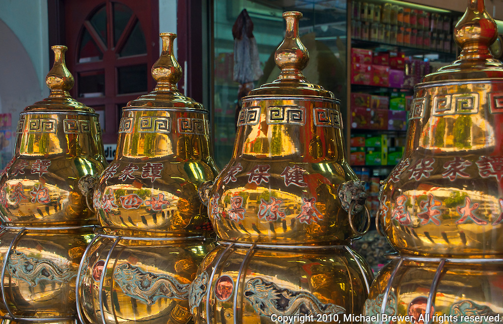 Shining brass urns for sale in Chinatown, Singapore.