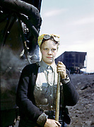 Fascinating Color Portrait Photos of Women Railroad Workers During WWII<br /> <br /> World War II began when Hitler's army invaded Poland on September 1, 1939. However, it wasn't until the day after the Japanese attacked Pearl Harbor on December 7, 1941, that the United States declared war on the Axis Powers.<br /> <br /> The railroads immediately were called upon to transport troops and equipment heading overseas. Soon the efforts increased to supporting war efforts on two fronts-- in Europe and in the Pacific.<br /> <br /> Prior to the 1940s, the few women employed by the railroads were either advertising models, or were responsible primarily for cleaning and clerical work. Thanks to the war, the number of female railroad employees rose rapidly. By 1945, some 116,000 women were working on railroads. A report that appeared on the 1943 pages of Click Magazine regarding the large number of American women who had stepped forward to see to it that the American railroads continued to deliver the goods during the Second World War:<br /> <br />     &quot;Nearly 100,000 women, from messengers aged 16 to seasoned railroaders of 55 to 65, are keeping America's wartime trains rolling. So well do they handle their jobs that the railroad companies, once opposed to hiring any women, are adding others as fast as they can get them...&quot;<br /> <br /> In April 1943, Office of War Information photographer Jack Delano photographed the women of the Chicago &amp; North Western Railroad roundhouse in Clinton, Iowa, as they kept the hulking engines cleaned, lubricated and ready to support the war effort.<br /> <br /> Photo shows: Mrs. Irene Bracker, mother of two, a wiper at the roundhouse.<br /> &copy;Library of Congress/Exclusivepix Media