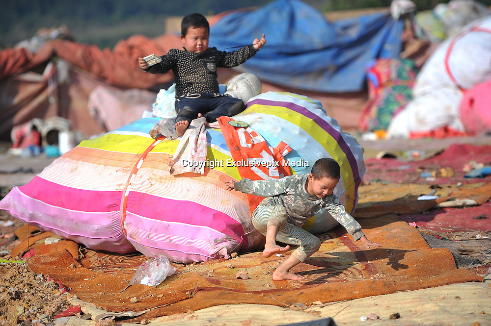 NANNING, CHINA - JANUARY 17: (CHINA OUT) <br /> <br /> Children play at the city's largest landfill site as their parents look for recyclable items to sell on January 17, 2016 in Nanning, Guangxi Zhuang Autonomous Region of China. Some children often help their parents make a living from the landfill site.<br /> ©Exclusivepix Media