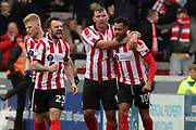 Lincoln City forward Matt Green (10) scores a goal 2-1 and celebrates  during the EFL Sky Bet League 2 match between Lincoln City and Exeter City at Sincil Bank, Lincoln, United Kingdom on 30 March 2018. Picture by Mick Atkins.