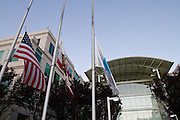 Flags fly at half mast at the Apple campus on 1 Infinite Loop in Cupertino, Calif., to remember CEO Steve Jobs on Oct. 6, 2011.  Jobs passed away on Oct. 5, 2011, after an eight year battle with pancreatic cancer.  Photo by Stan Olszewski/SOSKIphoto