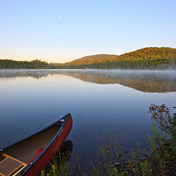 A canoe on Little Greenough Pond in Errol, New Hampshire.