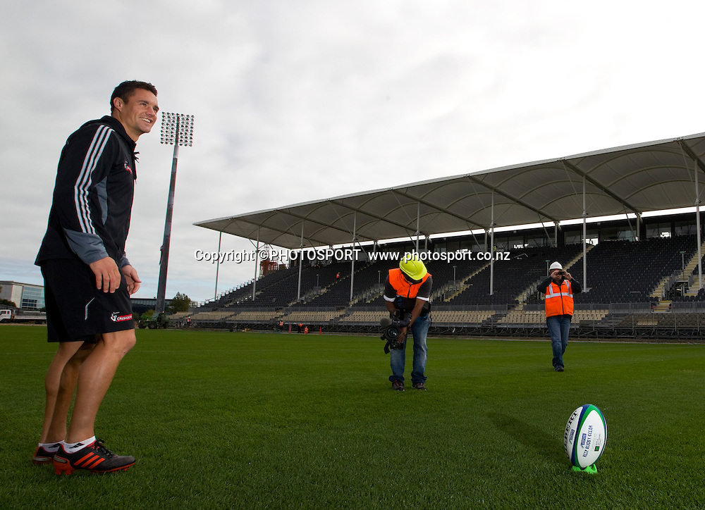 Dan Carter takes a kick at the posts on the newly laid turf at the new home of Crusaders and Canterbury Rugby. Dan Carter helped raise the goal posts and took the first kick at goal to mark the major milestone of bringing the Crusaders back home. The new Christchurch Stadium at Rugby League Park, Friday 16 March 2012. Photo : Joseph Johnson / photosport.co.nz