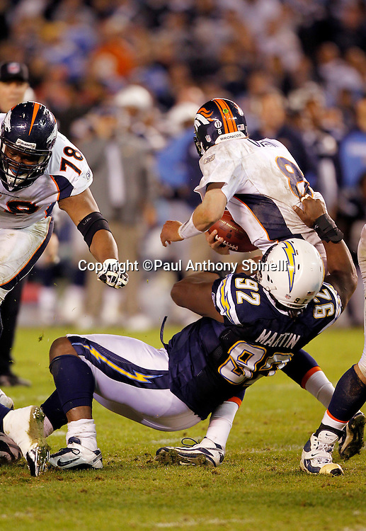 Denver Broncos quarterback Kyle Orton (8) gets sacked by San Diego Chargers defensive end Vaughn Martin (92) during the fourth quarter of the NFL week 11 football game against the San Diego Chargers on Monday, November 22, 2010 in San Diego, California. The Chargers won the game 35-14. (©Paul Anthony Spinelli)