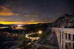 """Rainbow Bridge at Donner Lake 4"" - Photograph shot at night of Rainbow Bridge, light trails from a driving car, Donner Lake, and Truckee, California."