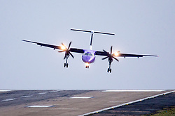 © Licensed to London News Pictures. 07/12/2017. Leeds UK. A Flybe aircraft is blown sideways as it attempt's to land in strong winds at England's highest airport, Leeds Bradford International, wind speeds are picking up as storm Caroline approaches. Photo credit: Andrew McCaren/LNP