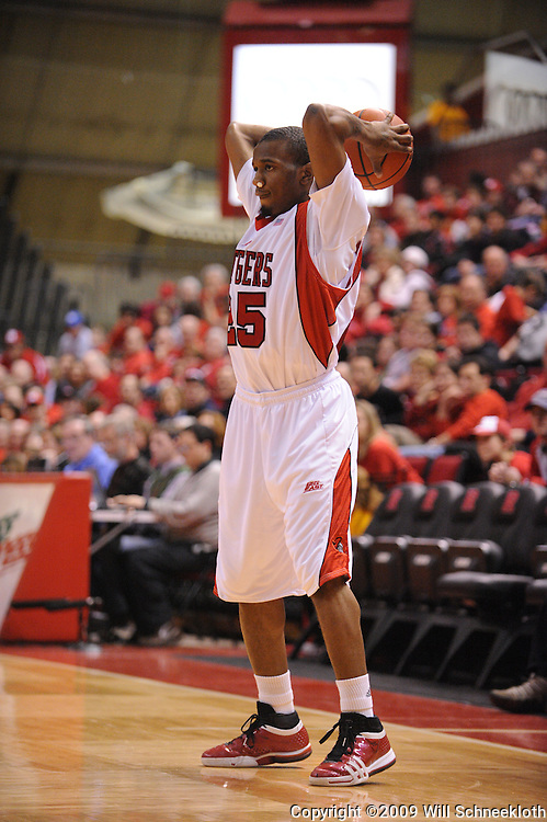 Jan 31, 2009; Piscataway, NJ, USA; Rutgers guard Corey Chandler (25) looks for an open pass during the second half of Rutgers' 75-56 victory over DePaul in NCAA college basketball at the Louis Brown Athletic Center