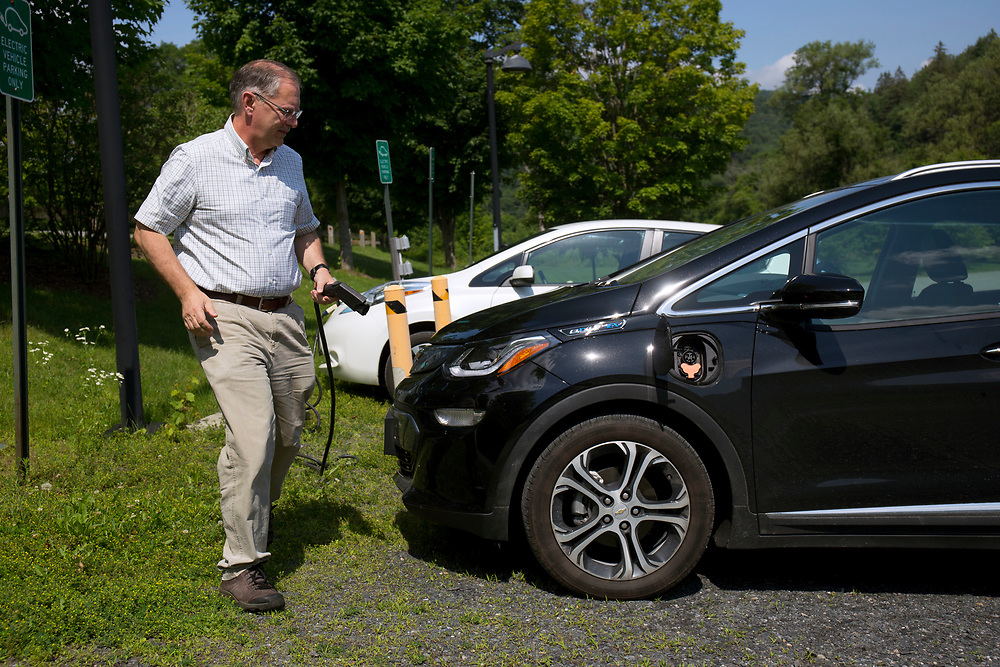 After arriving at work at Vermont Law School in South Royalton, Vt., on July 12, 2017, Kevin Jones, of Chittenden, Vt., plugs his Chevy Bolt into a Level 2 charging station at the school on July 12, 2017. The school has seven charging stations, four which are the higher-powered Level 2 stations. (Photo by Geoff Hansen)