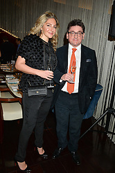 NICK & ELVIA HURRELL at a dinner hosted by AA Gill & Nicola Formby in support of the Borne charity held at Rivea at the Bulgari Hotel, Knightsbridge, London on 3rd February 2015.