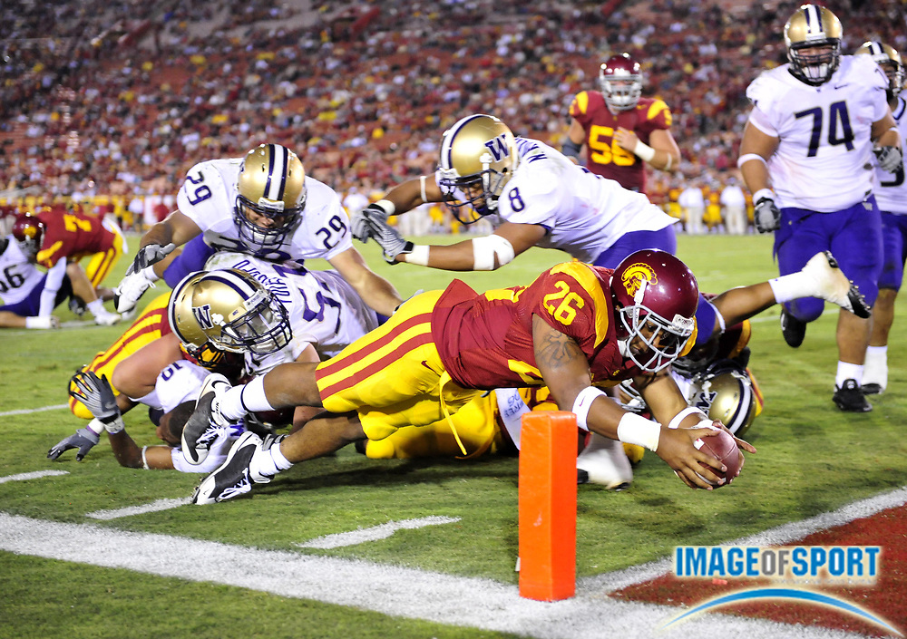 Nov 1, 2008; Los Angeles, CA, USA; Southern California Trojans tailback Marc Tyler (26) dives into the end zone to score on a 6-yard run in the fourth quarter of 56-0 victory over the Washington Huskies at the Los Angeles Memorial Coliseum.