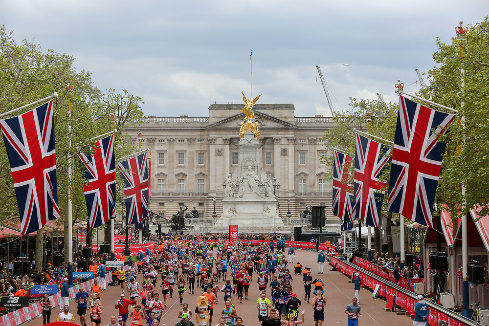 © Licensed to London News Pictures. 28/04/2019. London, UK. Mass runners approching the finish line of 2019 Virgin Money London Marathon with Buckingham Palace in the background. Photo credit: Dinendra Haria/LNP