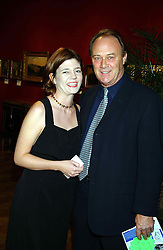 Actor CHRISTOPHER CAZENOVE and ISABEL DAVIS  at a private view and auction of a collection of paintings, drawings and doodles by well known personalities to mark the Book launch of Ackroyd's Ark in Christie's, 8 King Street, St.James's, London on 20th September 2004 in aid of Tusk Trust.<br /><br />NON EXCLUSIVE - WORLD RIGHTS
