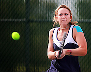 Xavier's Lisa Cowden, junior, returns the ball to Prairie's April McKeever (not pictured) during their match in the 1st round of the Regional Tennis Tournament at Xavier High School in Cedar Rapids on Saturday, May 15, 2010. Cowden defeated McKeever 6-0, 6-1 and Xavier defeated Prairie 5-0.