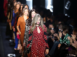 British model Cara Delevingne leads the rest of the models down the catwalk at the finale of  the Diane von Furstenberg  show at New York Fashion Week for Autumn/Winter 2013 , Sunday, 10th February 2013. Photo by: Stephen Lock / i-Images