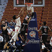 Malik Ellison, (left), St. John's, is rejected by Chris Silva, South Carolina, during the St. John's vs South Carolina Men's College Basketball game in the Hall of Fame Shootout Tournament at Mohegan Sun Arena, Uncasville, Connecticut, USA. 22nd December 2015. Photo Tim Clayton