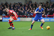 AFC Wimbledon defender Sean Kelly (22) tackling  during the EFL Sky Bet League 1 match between AFC Wimbledon and Walsall at the Cherry Red Records Stadium, Kingston, England on 25 February 2017. Photo by Matthew Redman.