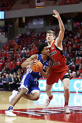 21 February 2018:  Jalen Gibbs pushes in against defender Matt Hein during a College mens basketball game between the Drake Bulldogs and Illinois State Redbirds in Redbird Arena, Normal IL