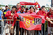Liverpool and Manchester United fans with flags and scarves during the Manchester United and Liverpool International Champions Cup match at the Michigan Stadium, Ann Arbor, United States on 28 July 2018.