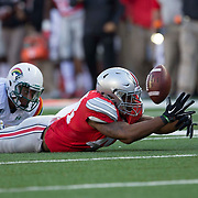 12 September 2015: Linebacker Darron Lee #43 of the Ohio State Buckeyes dives for a fumble during the game between the Ohio State Buckeyes and the University of Hawaii Rainbow Warriors at the Ohio Stadium in Columbus, Ohio.