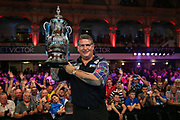 Gary Anderson receives the trophy after his victory over Mensur Suljovic during the BetVictor World Matchplay Darts 2018 final at Winter Gardens, Blackpool, United Kingdom on 29 July 2018. Picture by Shane Healey.