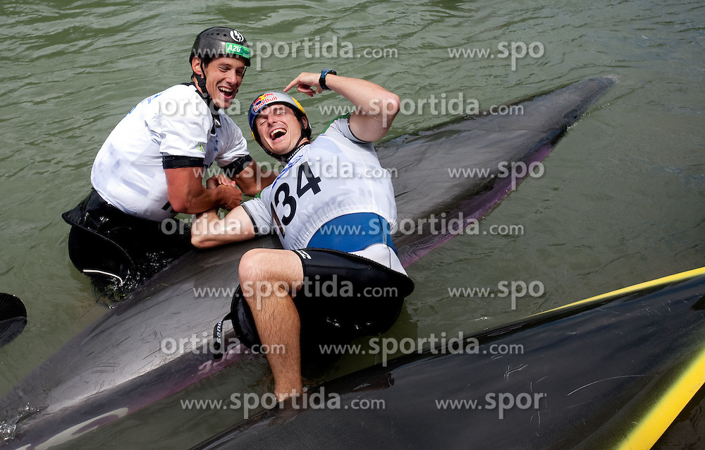 Second placed Jure Meglic and winner Peter Kauzer of Slovenia celebrate after the final race at ICF Canoe Slalom World Cup Sloka 2011, on June 25, 2011, in Tacen, Ljubljana, Slovenia. (Photo by Vid Ponikvar / Sportida)