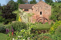 old water mill converted into a house with well planted garden