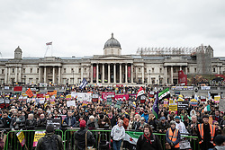 © Licensed to London News Pictures. 19/03/2016. London, UK. Demonstrators stand in Trafalgar Square to listen to speeches about the plight of refugees and asylum seekers across Europe. Thousands march through central London on UN anti-racism day to demand that the British government accept a greater share of refugees seeking asylum in Europe. Photo credit : Rob Pinney/LNP