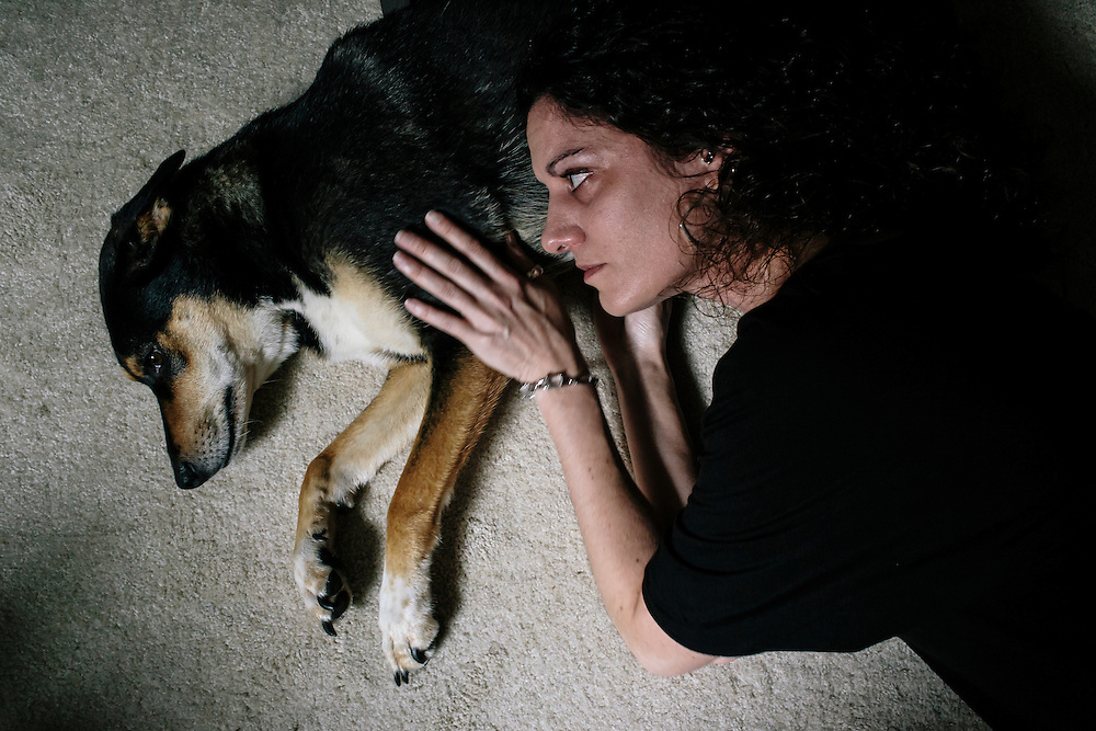 Janet Mihalyfi comforts her dog Raz at her home in Georgetown. For nearly a year, Mihalyfi has been trying to track down Havoc, her other five-year-old black and tan mix breed. Mihalyfi has spent nearly $30,000 to try and find her.