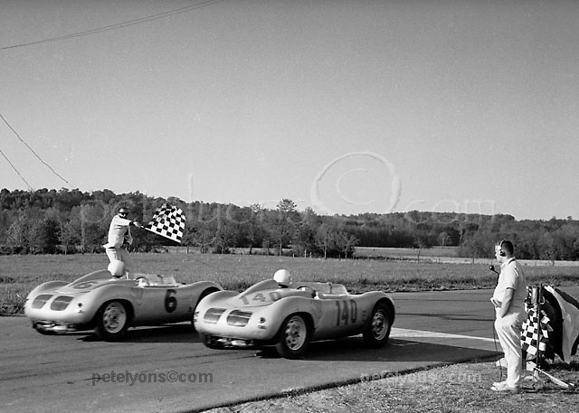 Bob Holbert, winner in Porsche 140, and Roger Penske taking flag at VIR 1960; Ozzie Lyons photo