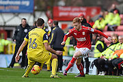 Swindon Town Defender, James Brophy (11) takes on Oxford United Defender, Phil Edwards (16) during the EFL Sky Bet League 1 match between Swindon Town and Oxford United at the County Ground, Swindon, England on 5 February 2017. Photo by Adam Rivers.