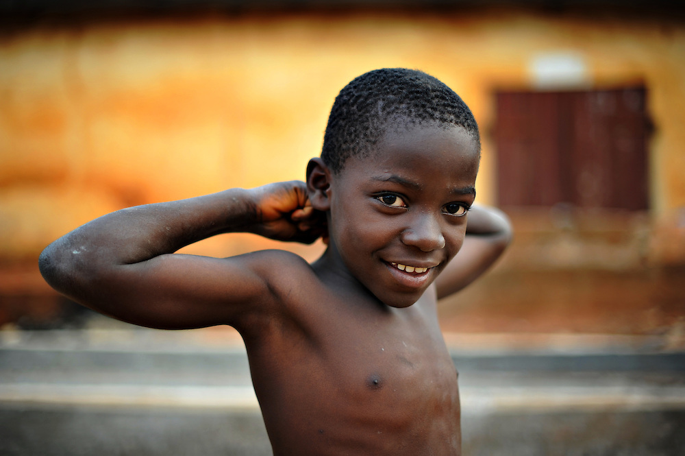 12-01-16  --  LOME, TOGO  -- A boy shows off his muscles in the Forever neighbourhood of Lome, Togo on January 16, 2012.  Photo by Daniel Hayduk
