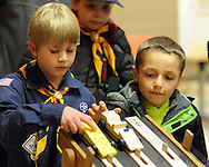 Matthew Nepalis (L), 8, and Simon Siliverdis, 6 place their pinewood derby cars on a track for a test run as the Society of Bucks Engineers, and members of Cub Scout Pack 46 discuss the best way to construct and race a small model car made out of a block of pine wood Friday, February 20, 2015 in Newtown, Pennsylvania. (Photo by William Thomas Cain/Cain Images)
