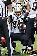 NEW ORLEANS, LA - SEPTEMBER 20:  Cameron Jordan #94 of the New Orleans Saints is helped up during a game against the Tampa Bay Buccaneers at Mercedes-Benz Superdome on September 20, 2015 in New Orleans Louisiana.  The Buccaneers defeated the Saints 26-19. (Photo by Wesley Hitt/Getty Images) *** Local Caption *** Cameron Jordan