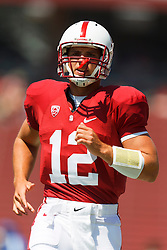 September 3, 2011; Stanford, CA, USA;  Stanford Cardinal quarterback Andrew Luck (12) warms up before the game against the San Jose State Spartans at Stanford Stadium.