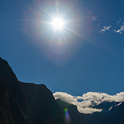 Mountain peak at Milford Sound with sun flare
