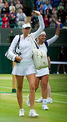 LONDON, ENGLAND - Monday, July 2, 2012: Maria Sharapova (RUS) walks off after losing to Sabine Lisicki (GER) during the Ladies' Singles 4th Round match on day seven of the Wimbledon Lawn Tennis Championships at the All England Lawn Tennis and Croquet Club. (Pic by David Rawcliffe/Propaganda)