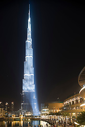 Night view of floodlit Burj Khalifa Tower in Dubai United Arab Emirates