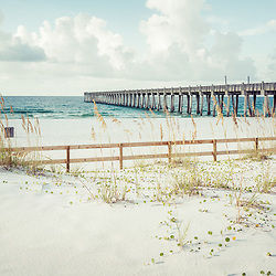 Pensacola Beach Gulf Pier and wooden fence on Casino Beach. Pensacola Beach is a coastal city along the Emerald Coast in the Southeastern United States. Photo is high resolution. Copyright ⓒ 2018 Paul Velgos with All Rights Reserved.