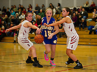 Belmont's Makayla Donovan and Courtney Clairmont putting pressure on Gilford's Julia Harris during NHIAA Division III basketball on Wednesday evening.  (Karen Bobotas/for the Laconia Daily Sun)