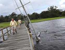 Local residents arriving to check on their boats pass by a sailboat sitting on the bottom at Langs Marina after Hurricane Irma hit the town on Monday, September 11, 2017, in St. Marys, GA, USA. Photo by Curtis Compton/Atlanta Journal-Constitution/TNS/ABACAPRESS.COM