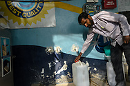 A customer puts a cap on a water can at a Safe Water Network iJal station in Rangsaipet, in Waragal, Telangana, Indiia, on Sunday, February 10, 2019. Photographer: Suzanne Lee for Safe Water Network