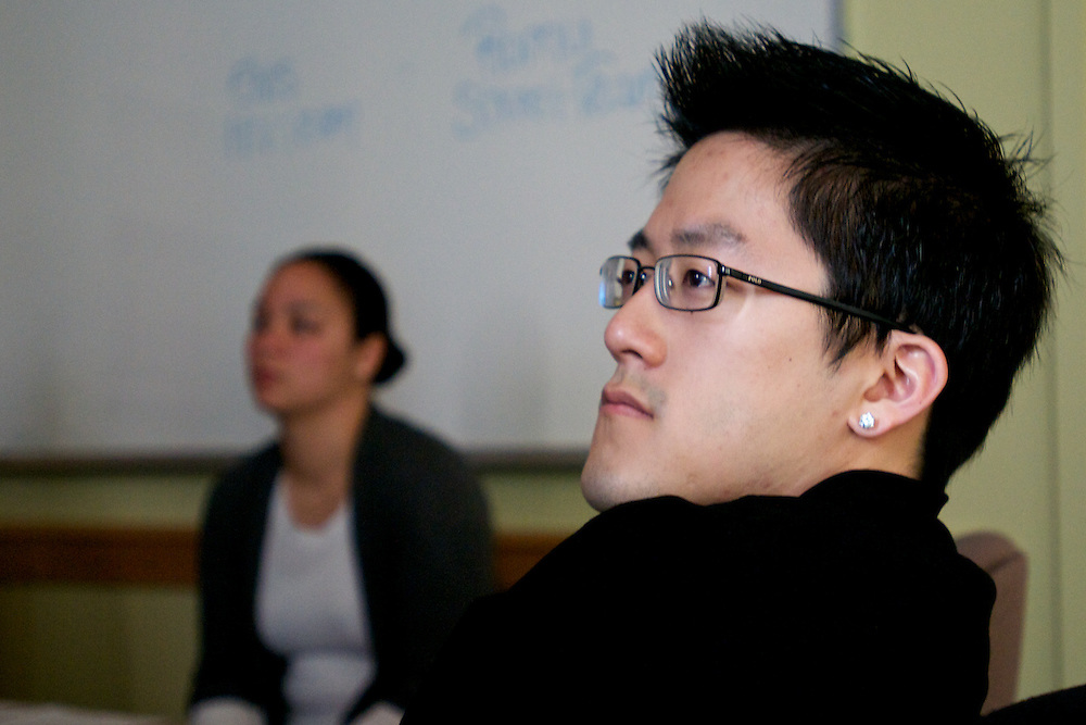 April 16, 2011 - Cecil Yeung watches a short video about Boston Health Care for the Homeless before volunteering at the Barbara McInnis House as a part of Global Day of Service. Yeung graduated from Boston University in 2009 with degrees in neurobiology and economics.