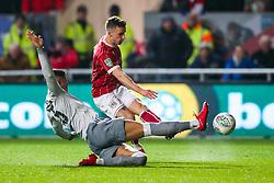 Joe Bryan of Bristol City scores a goal to make it 1-0 as Marcos Rojo of Manchester United challenges  - Rogan/JMP - 20/12/2017 - Ashton Gate Stadium - Bristol, England - Bristol City v Manchester United - Carabao Cup Quarter Final.