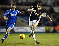 Photo: Chris Ratcliffe.<br /> Millwall v Hull FC. Coca Cola Championship. 14/02/2006.<br /> Jon Parkin of Hull scores as Tony Craig  of Millwall watches on