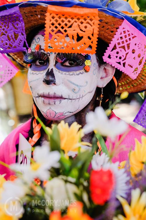 A woman participates in a Dia de los Muertos pageant