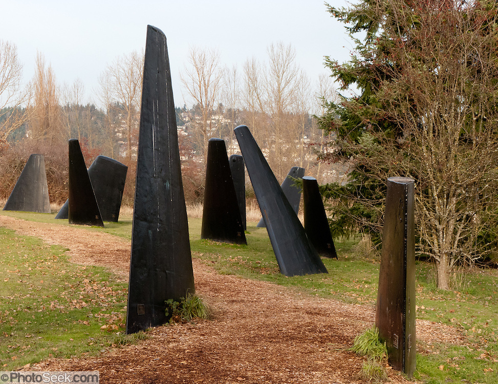 """Twenty-two decommissioned diving plane fins (10,000 pounds each) from 1960's U.S. Navy attack submarines have become art. """"The Fin Project: From Swords to Plowshares"""" is a sculptural installation made from submarine fins arranged to represent a pod of whales. Dedicated in 1998, the art work was created by John T. Young at Warren G. Magnuson Park North loop trail below Sand Point (Kite Hill), at Sand Point Way NE and NE 65th Street, Seattle, Washington."""