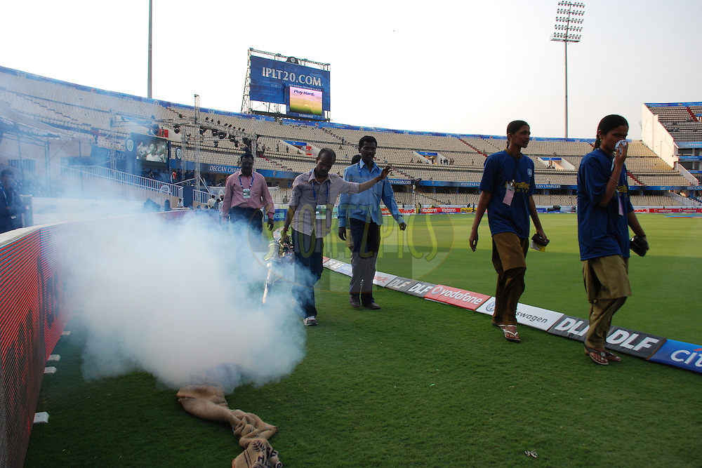 Ground staff spreaying mosquito spray during match 11 of the Indian Premier League ( IPL ) between the Deccan Chargers and the Royal Challengers Bangalore held at the Rajiv Gandhi International Cricket Stadium in Hyderabad on the 14th April 2011..Photo by Saikat Das/BCCI/SPORTZPICS