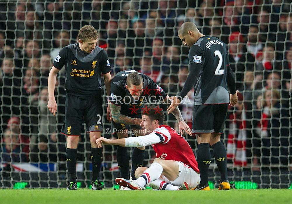 LONDON, ENGLAND - Wednesday, January 30, 2013: Liverpool's Daniel Agger and Arsenal's Oliver Giroud clash during the Premiership match at the Emirates Stadium. (Pic by David Rawcliffe/Propaganda)
