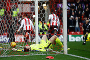 Rotherham United goalkeeper Lewis Price (12) lay defeated in hit goal as Brentford defender Nico Yennaris (8) celebrates during the EFL Sky Bet Championship match between Brentford and Rotherham United at Griffin Park, London, England on 25 February 2017. Photo by Andy Walter.
